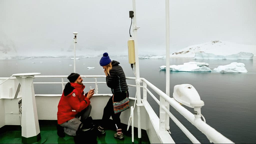 A couple getting engaged in antarctica: engagement in antarctica; proposal antarctica; antarctica cruise